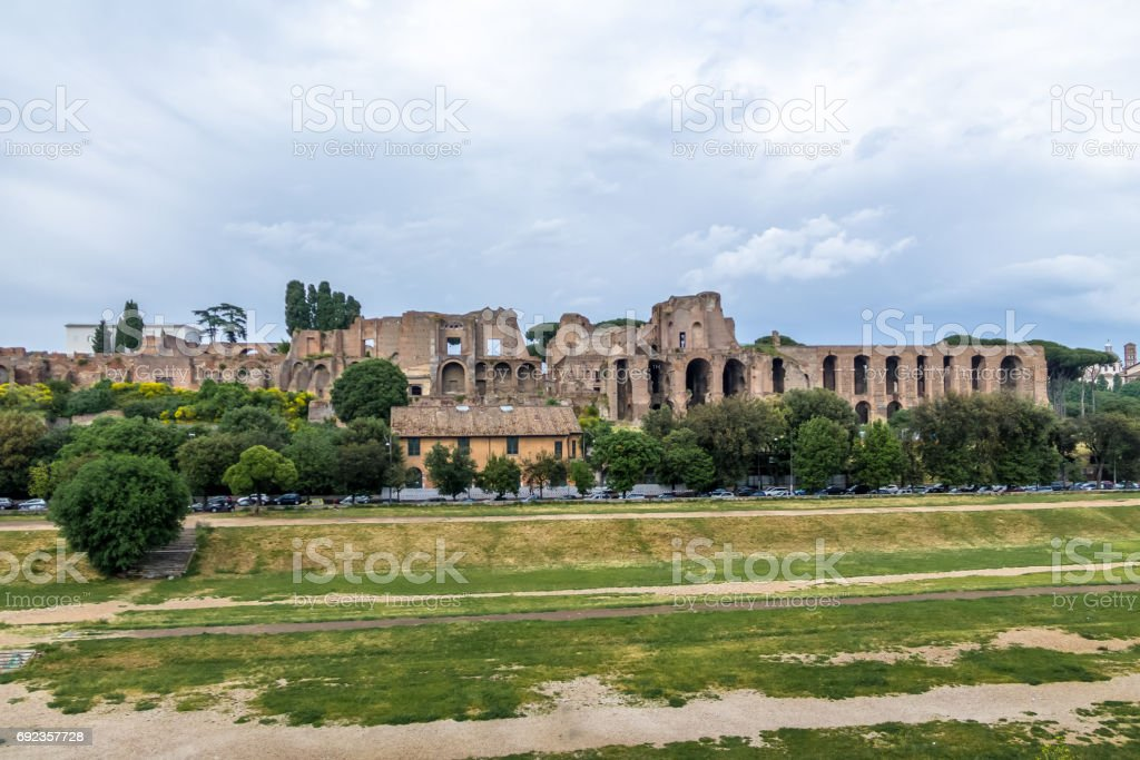 View of Palatine Hill and Imperial Palace from Circus Maximus field (an ancient chariot racing stadium) - Rome, Italy stock photo