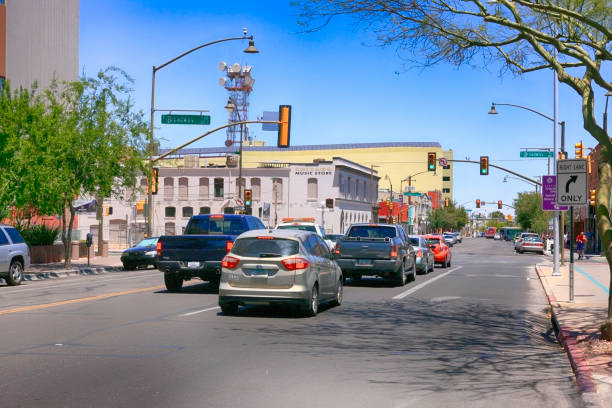 View of people and vehicles in downtown 6th and Broadway in Tucson AZ stock photo