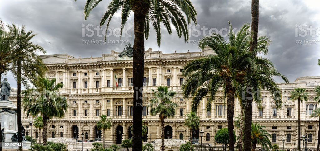 View of Piazza Cavour with the facade of the Supreme Court of Cassation in Rome, Italy. Sky with many dark clouds stock photo