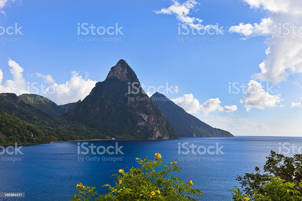 View of Pitons, St. Lucia depicting mountains and the ocean stock photo