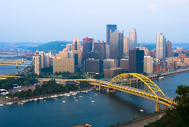 View of Pittsburgh, Pennsylvania skyline during the day View of downtown Pittsburgh, Pennsylvania with concert at Point State Park pittsburgh stock pictures, royalty-free photos & images