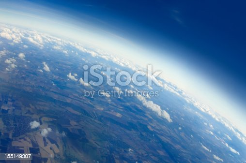 Aerial view of Planet Earth with clouds, horizon and little bit of space, make feelings of being in heaven. Cloudscape and stratosphere from above at 30000 feet.