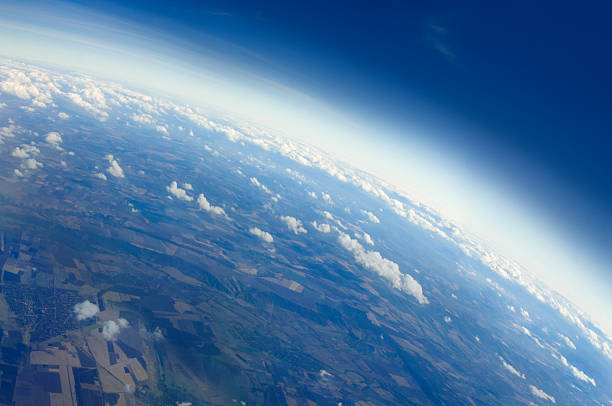 View of Planet Earth Aerial view of Planet Earth with clouds, horizon and little bit of space, make feelings of being in heaven. Cloudscape and stratosphere from above at 30000 feet. altocumulus stock pictures, royalty-free photos & images