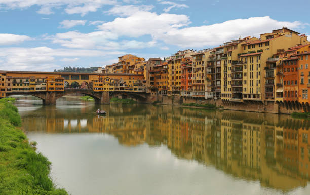 View of Ponte Vecchio the famous arch bridge across Arno river in Florence (Firenze), Tuscany, Italy stock photo