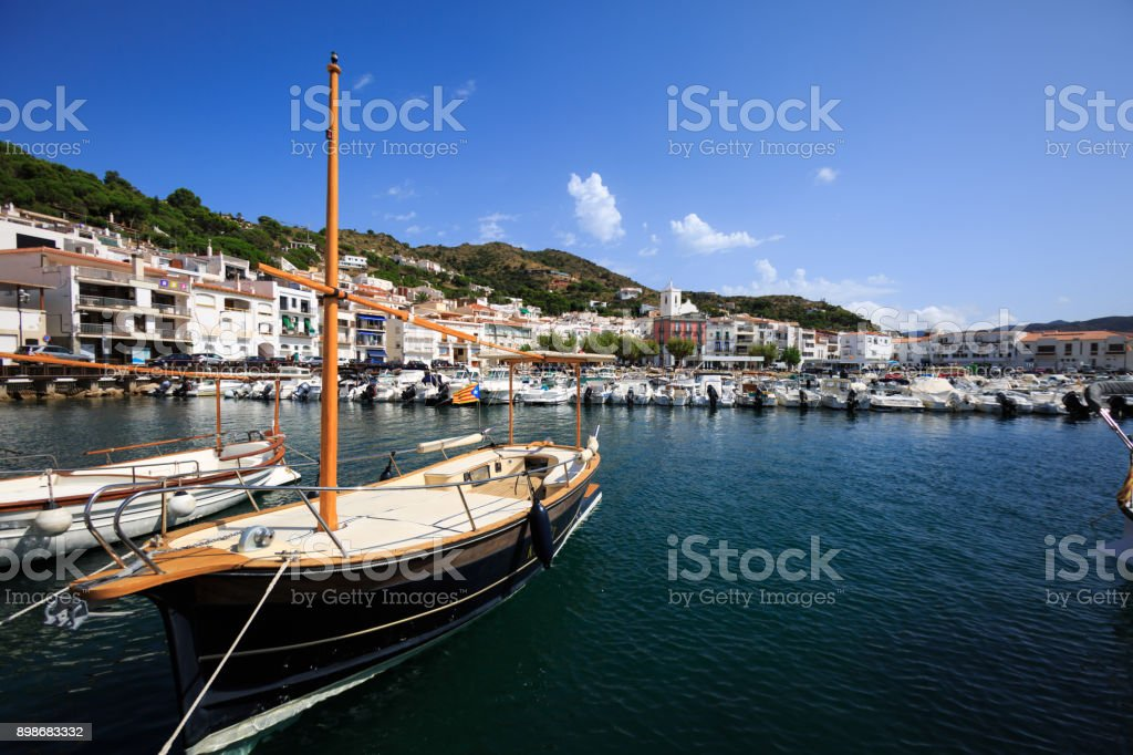 View of Port de la Selva a typical boat in the foreground stock photo