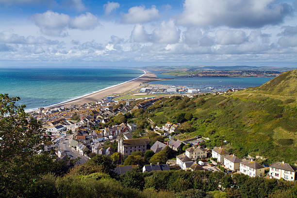 view of portland chesil beach and weymouth dorset - weymouth stock photos and pictures