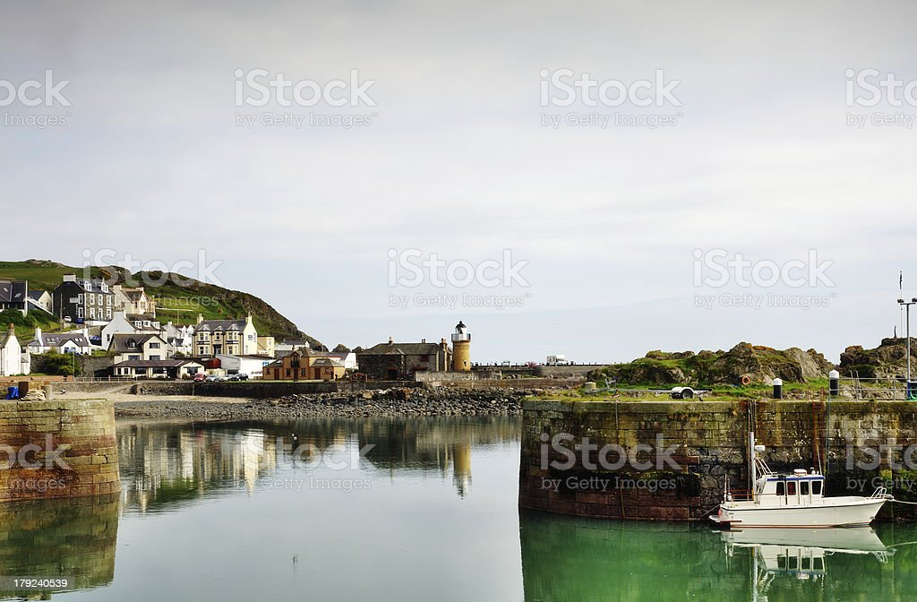 View of Portpatrick harbour with boat royalty-free stock photo