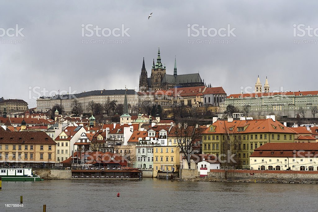 View of Prague with Castle and river under Dramatic Sky stock photo