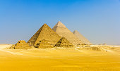 View of pyramids from the Giza Plateau: three Queens' Pyramids, the Pyramid of Menkaure, the Pyramid of Khafre and the Great Pyramid of Giza (Khufu or Cheops)