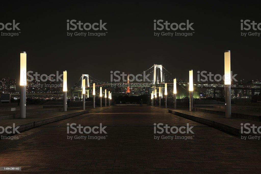 View of Rainbow Bridge  at night with Tokyo Tower stock photo