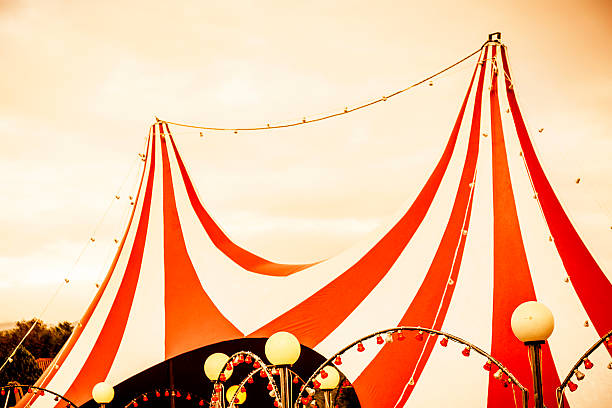 view of red and white striped circus tent top  - circus stok fotoğraflar ve resimler