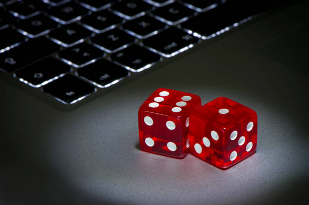 View of red dices to gamble and play online stock photo