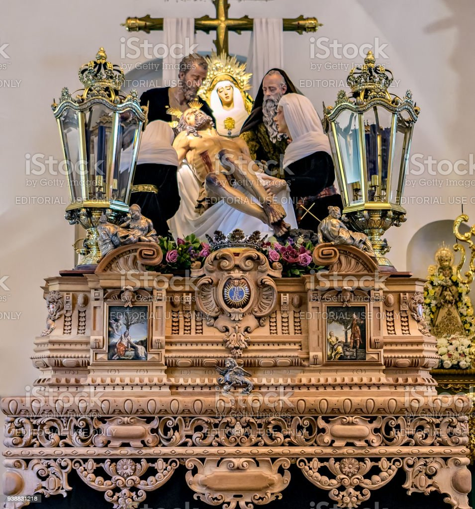 View of religious float that takes part in Huelva Easter celebration parade. stock photo