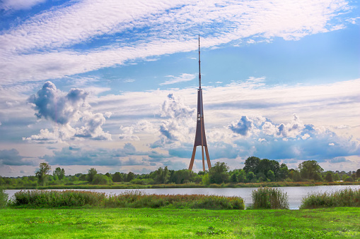 View of Riga Radio and TV Tower and cloudy sky in Riga, Latvia. It is the tallest tower in the European Union