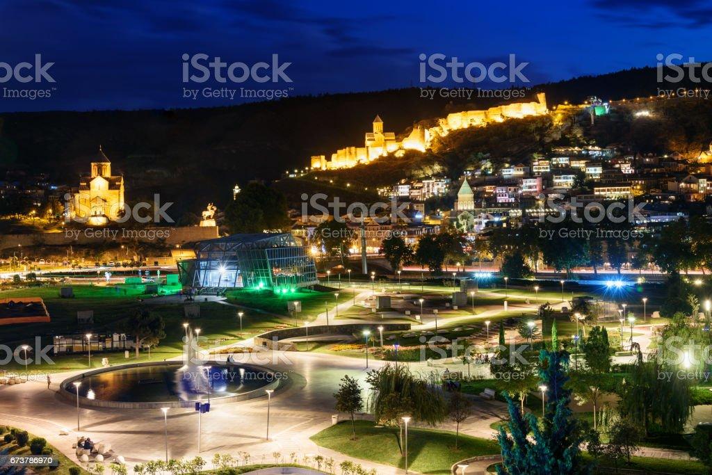 View of Rike Park Old city, Metekhi bridge and church and Narikala fortress at night. Tbilisi, Georgia stock photo