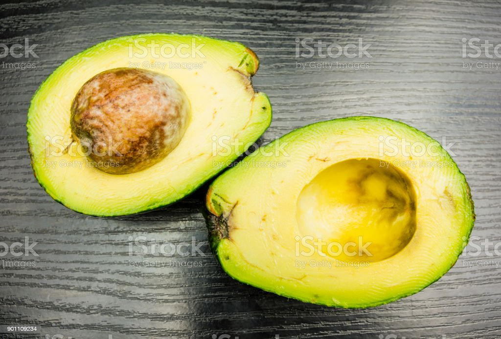 View of ripe cut avocado. stock photo