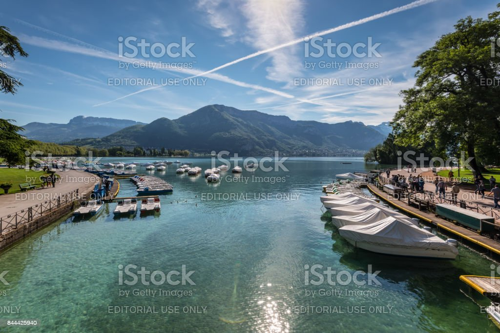 Annecy, France - May 25, 2016: View of river mouth, lake and boat from Pont des Amours (Bridge of Love) in Annecy, France. Annecy is a commune in the Haute Savoie department of the Rhone-Alpes region in south-eastern France. stock photo