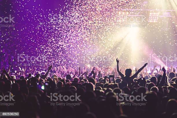 View of rock concert show in big concert hall with crowd and stage a picture id692536250?b=1&k=6&m=692536250&s=612x612&h=ujwrav467b7bledwsdzxi6 yxgeidcedw6h5tv4q lg=