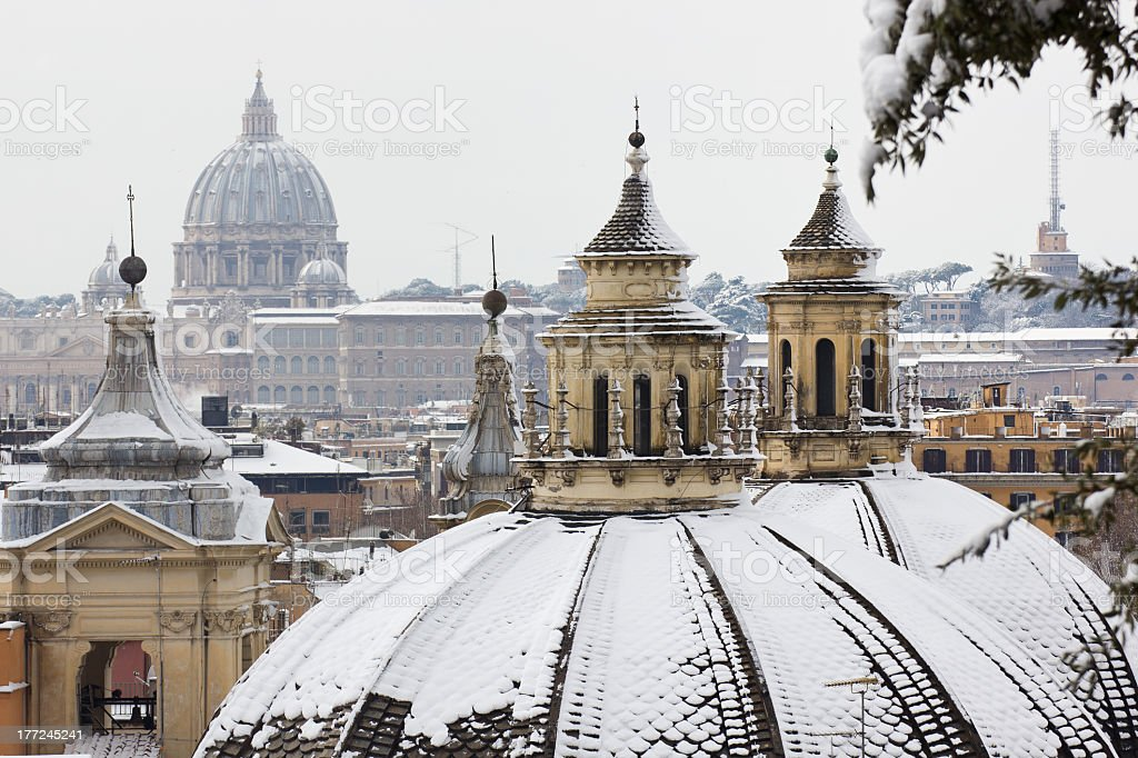 View of rooftops of Rome with snow from Borghese gardens stock photo