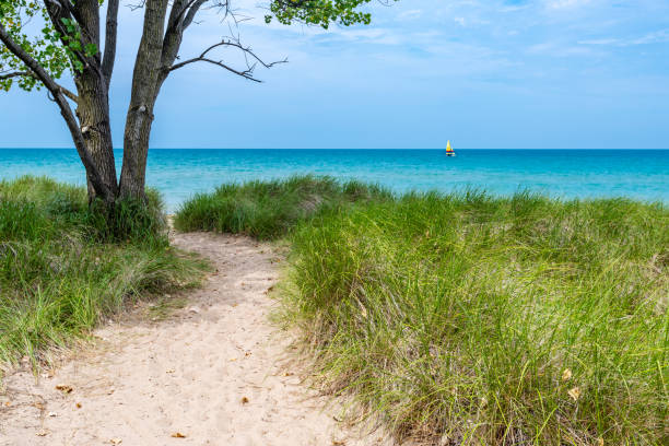 View of Sailboat on Lake Michigan From Beach stock photo