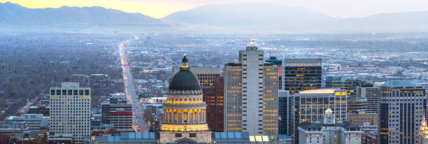 view of salt lake city at dawn - skyline mountains usa stock photos and pictures