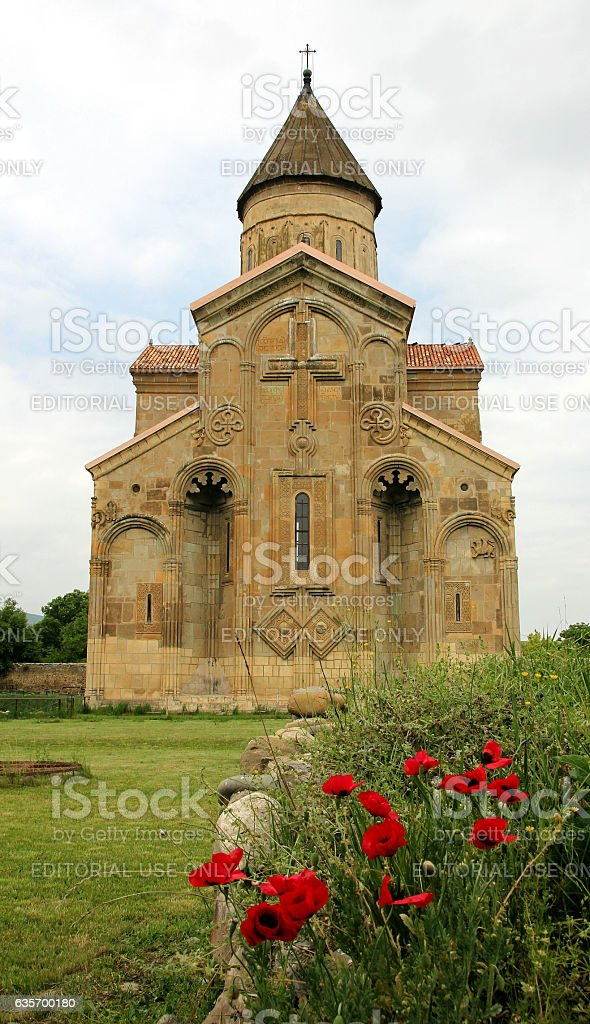 View of Samtavisi Cathedral with red flowers royalty-free stock photo