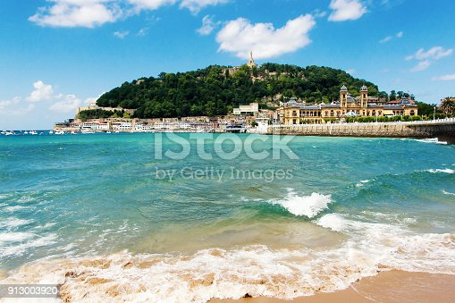 istock View of sandy beach of San Sebastian (Donostia), Spain in a lovelyl summer day. San Sebastian is one of the most famous tourist destinations in Spain 913003920