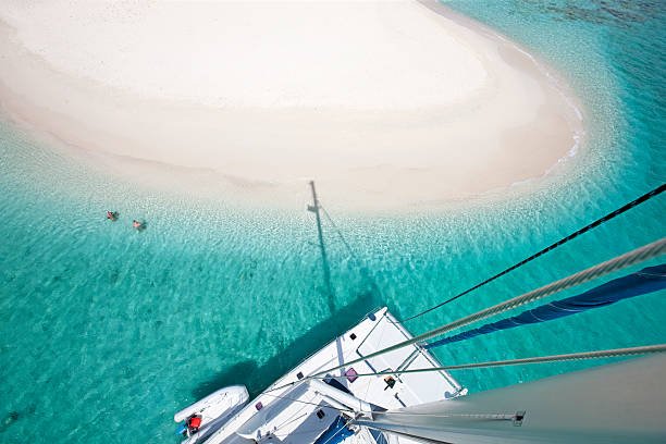view of sandy spit, bvi from the catamaran's mast - katamaran bildbanksfoton och bilder