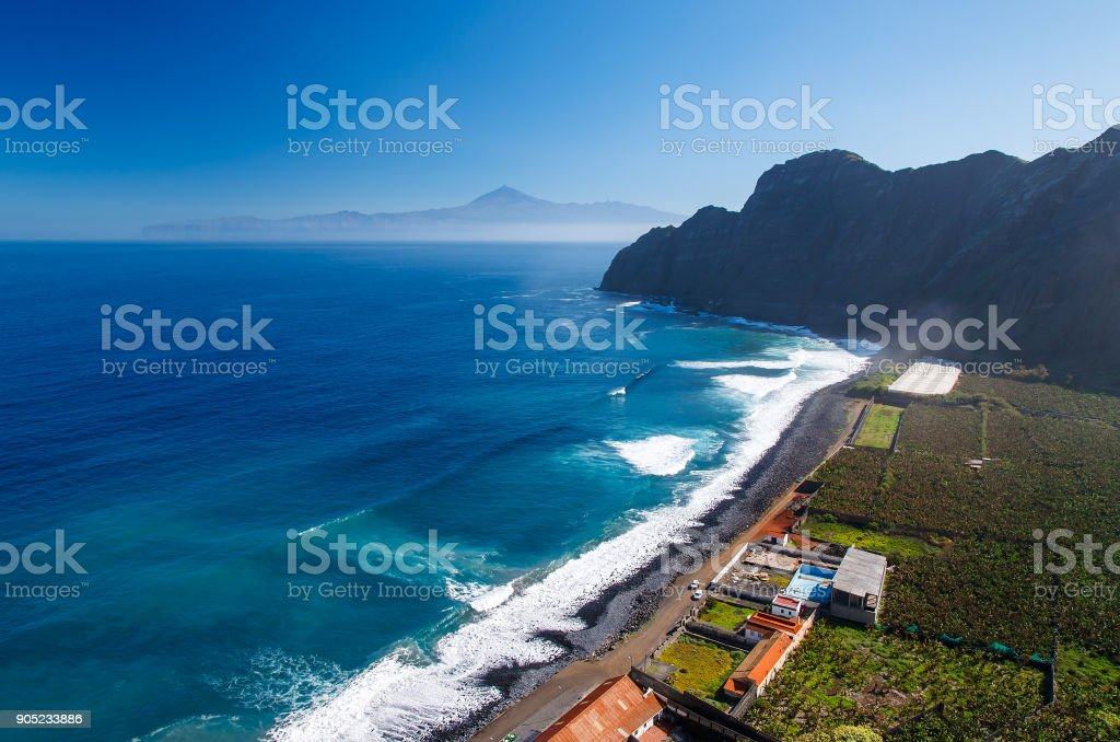 View of Santa Catalina beach and mountains with Tenerife island in the background, La Gomera island, Spain stock photo
