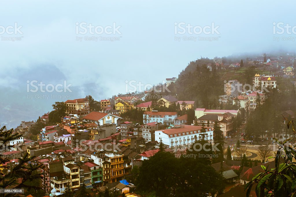 View of Sapa city in the mist, Vietnam stock photo