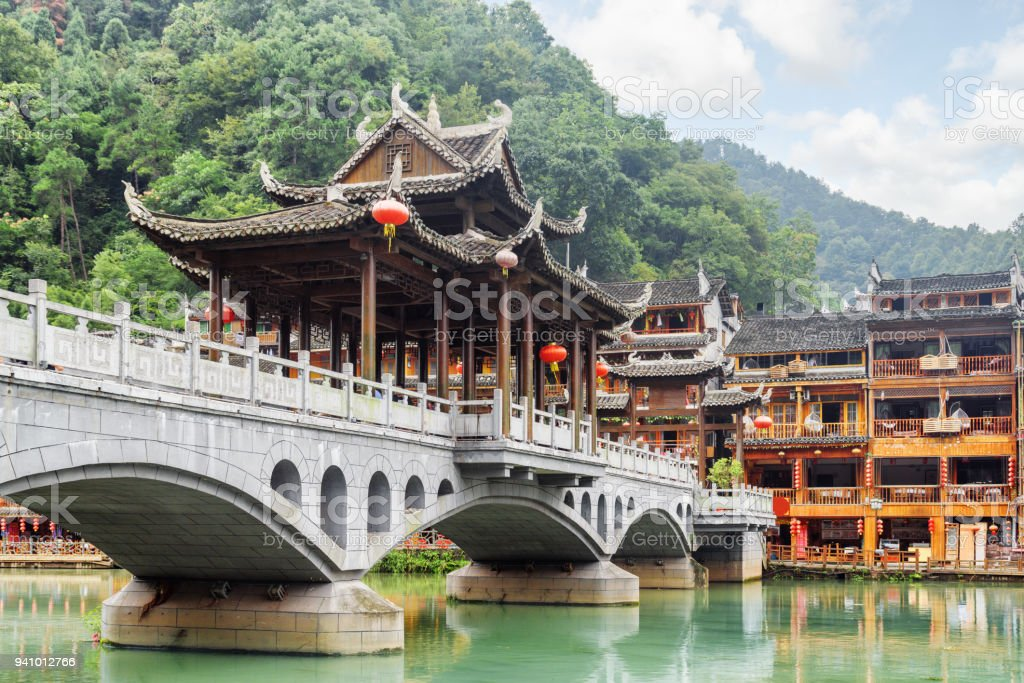 View of scenic bridge on wooded mountains background, Fenghuang stock photo