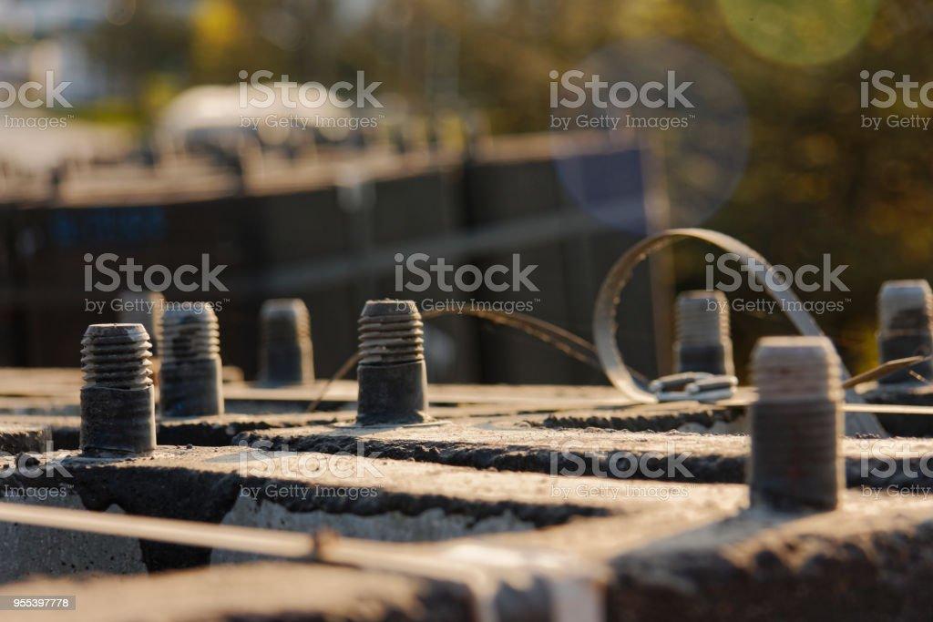 View of screws in concrete - Zbiór zdjęć royalty-free (Betonowy)