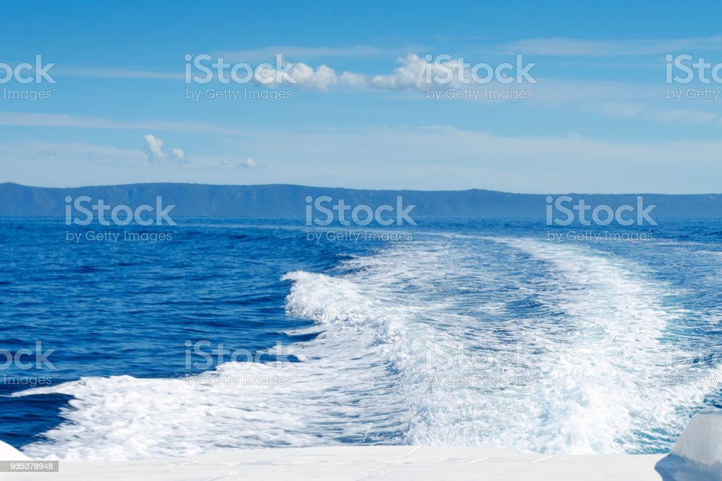 view of sea and sky from motorboat at great speed stock photo