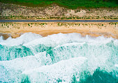 Aerial view of sea, beach and waves.