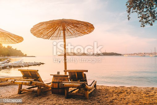 view of sea beach with sun loungers and umbrellas. copy space