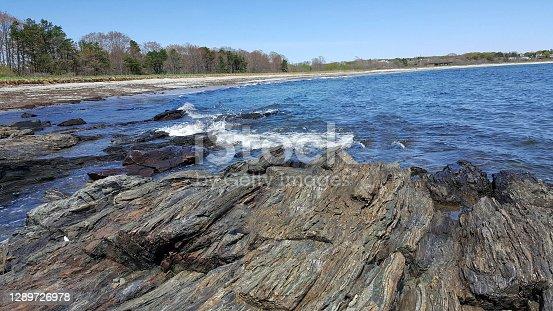 view of sea waves and fantastic big rock at Acadia National Park