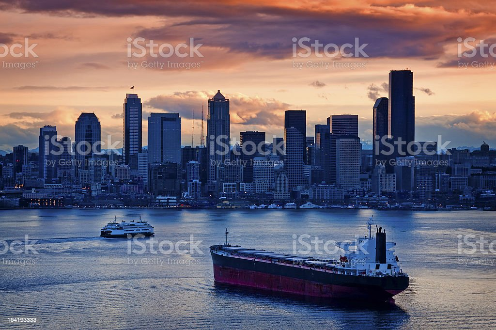 A view of Seattle from the harbor during sunrise stock photo