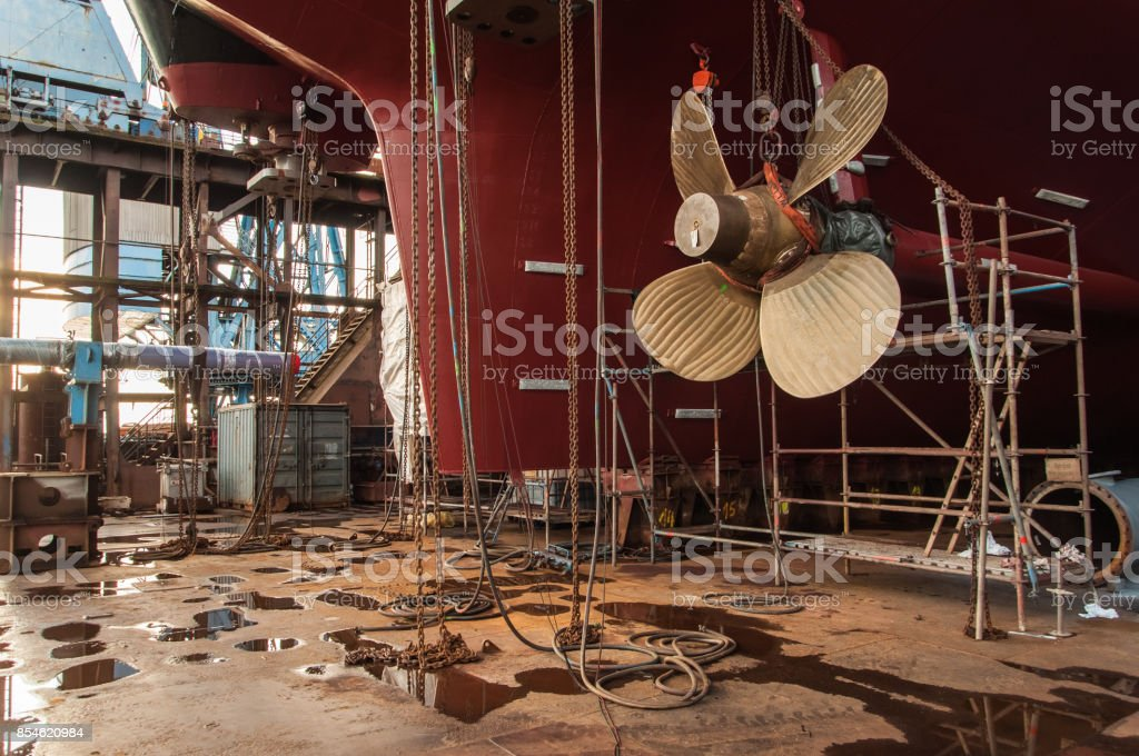 View of ships rudder and propeller in dry dock stock photo