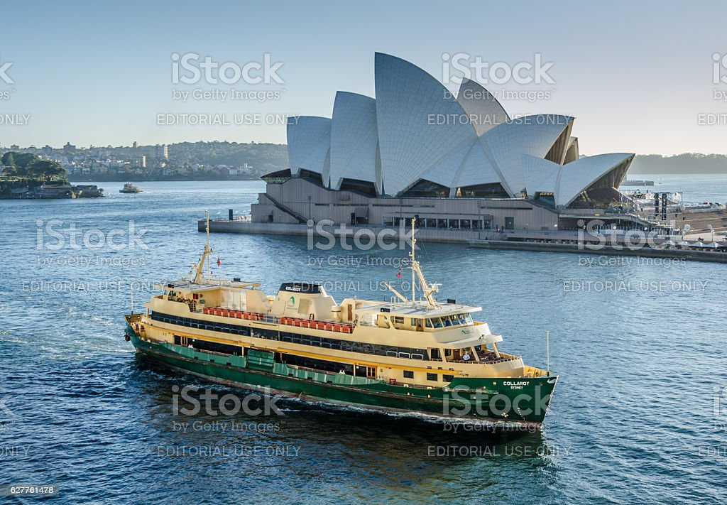 View of Sidney Opera House and ferry at dawn stock photo