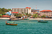 Sihanoukville, Cambodia. View from the sea to the city beach and boat pier
