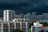 View of Singapore cityscape from Mount Faber. Dark clouds approaching . Landscape shot
