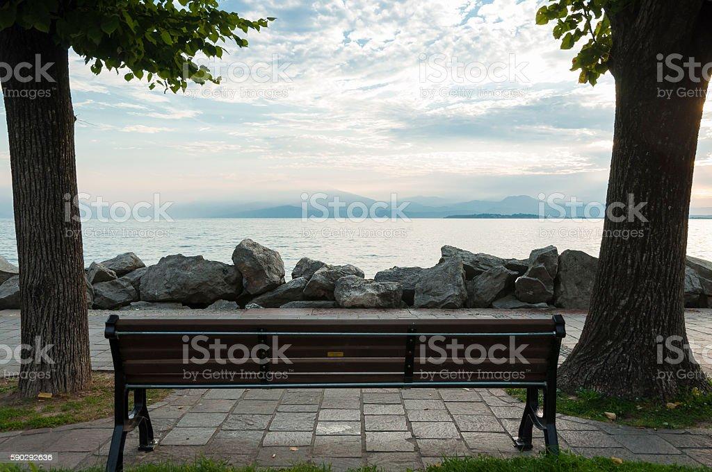 View of Sirmione, Lake garda from a bench in Desenzano royaltyfri bildbanksbilder