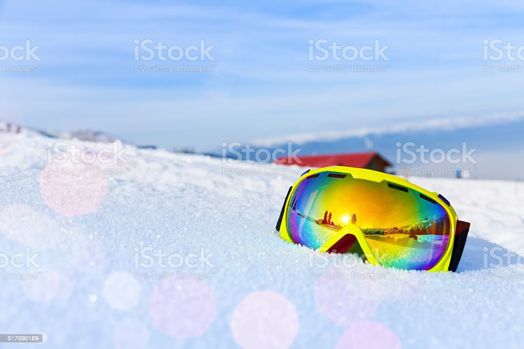 View of ski mask with mountain's reflection stock photo