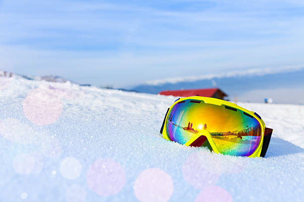 View of ski mask with mountain's reflection View of yellow ski mask with reflection of mountain on white icy snow ski goggles stock pictures, royalty-free photos & images