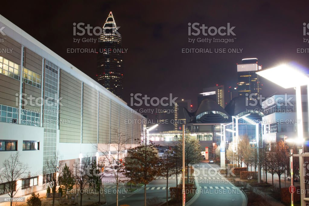 View of skyscrapers and Messe Frankfurt at night. stock photo