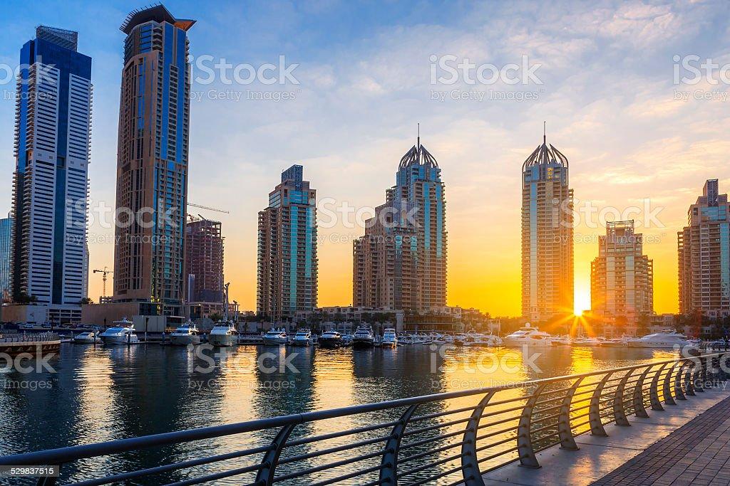 View of Skyscrapers in Dubai Marina at sunrise stock photo