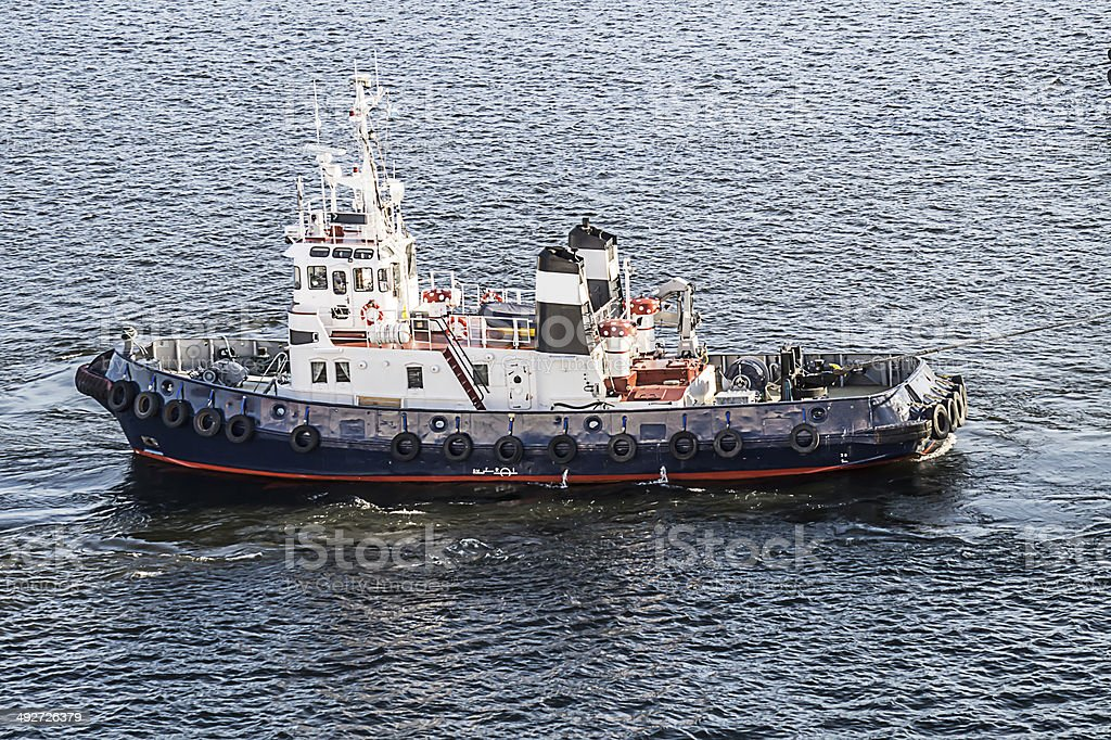 View of smaller boat at sea stock photo