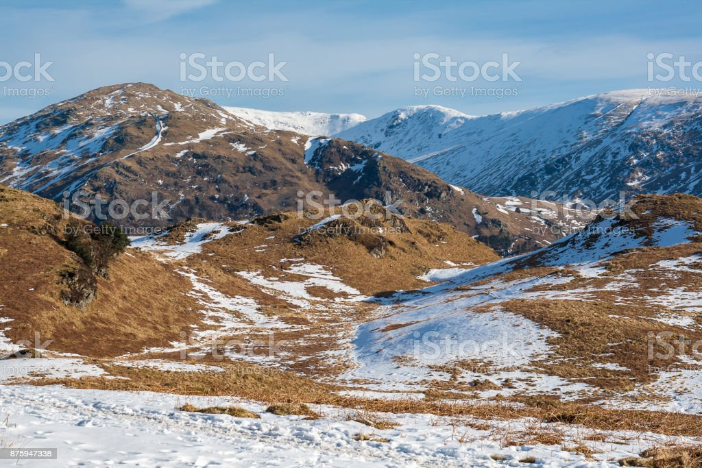 View of Snow covered mountains from Loughrigg in Lake District stock photo