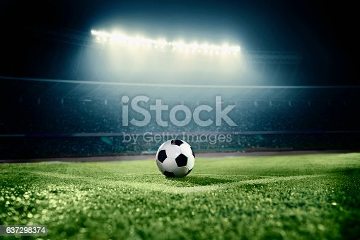 637298374istockphoto View of soccer ball on athletic field in stadium arena 637298374