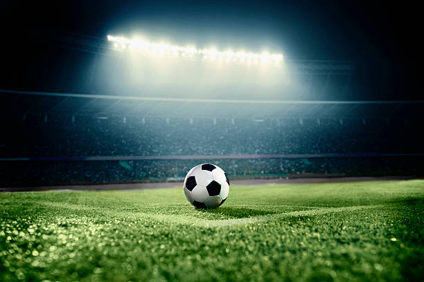 view of soccer ball on athletic field in stadium arena - football stok fotoğraflar ve resimler